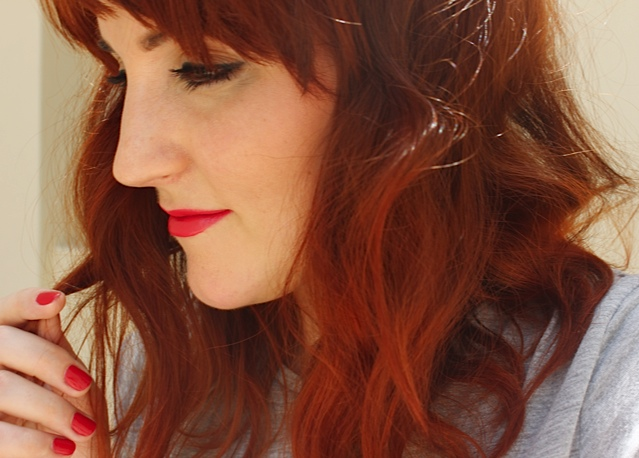 Red hair, lips and nails